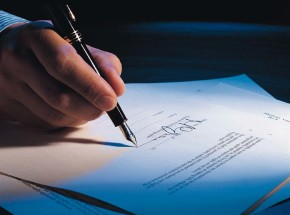 072019A - Business man, hand holding pen, signing contract,