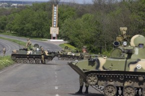 Ukrainian soldiers, supported by armoured personnel carriers, man a checkpoint near the town of Slaviansk in eastern Ukraine